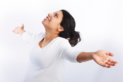 Woman praising with arms raised in the air