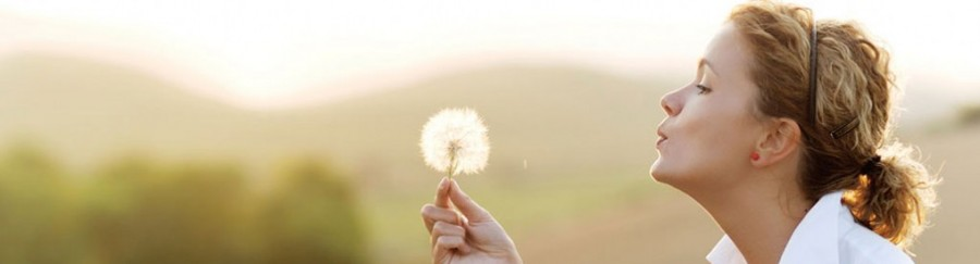 banner-woman-blowing-dandelion