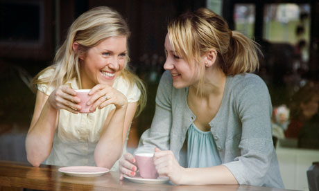 Two women having a cup of coffee in a cafe Sweden.