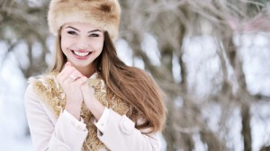 beautiful-smiling-girl-wearing-fur-hat-wallpaper_2078424173